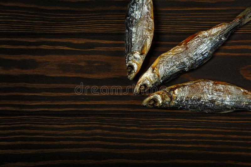 Three dried fish royalty free stock images