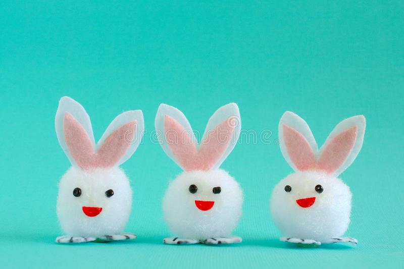 Three Easter Bunnies on Aqua Background stock image