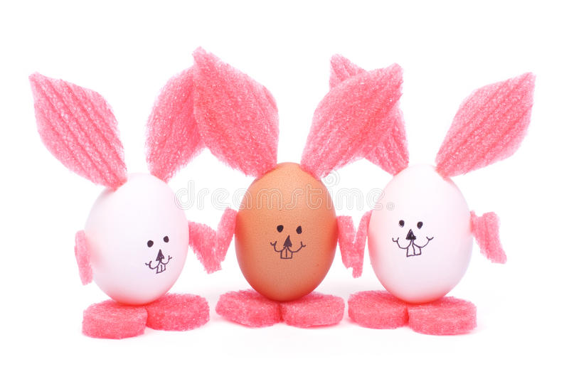 Three Easter bunny with pink ears made of eggs royalty free stock photos