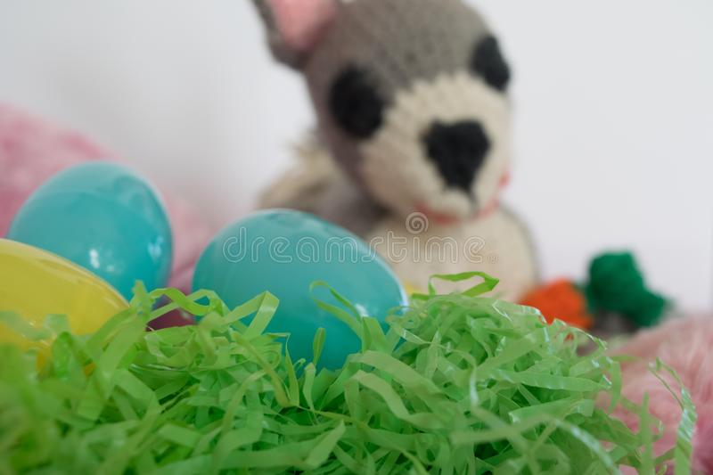 Three Easter eggs and crocheted amigurumi bunny stock photos