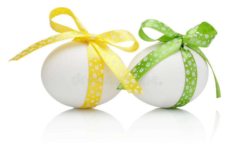 Three Easter eggs with festive bow isolated stock photos