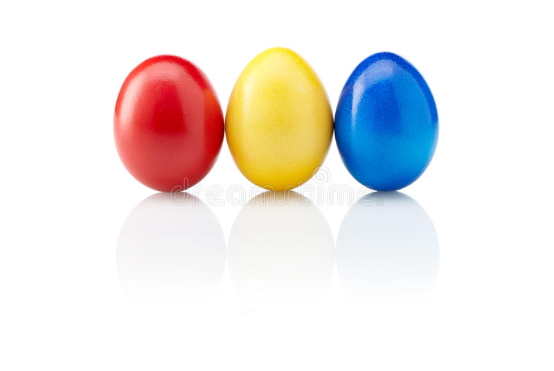 Three easter eggs isolated. Three different colored isolated easter eggs royalty free stock images