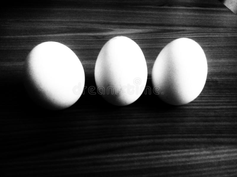 Three eggs in black and white stock photos