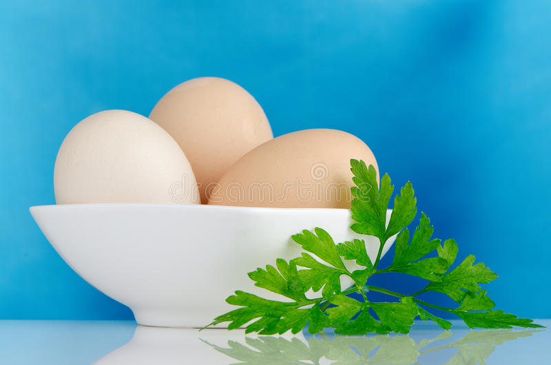 Three eggs in the bowl stock photo