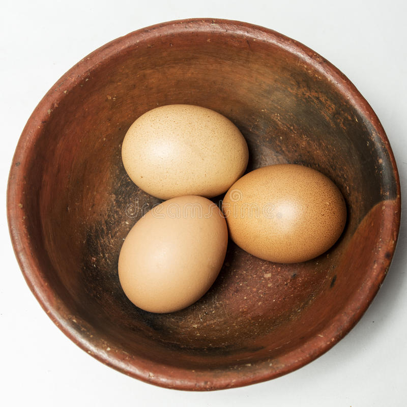 Three eggs in a bowl royalty free stock photography