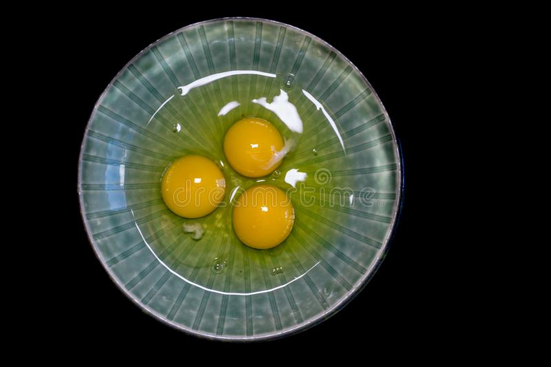 Three eggs cracked in a bowl royalty free stock image