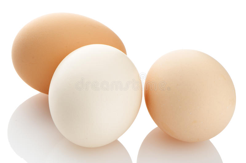 Three eggs on white royalty free stock images