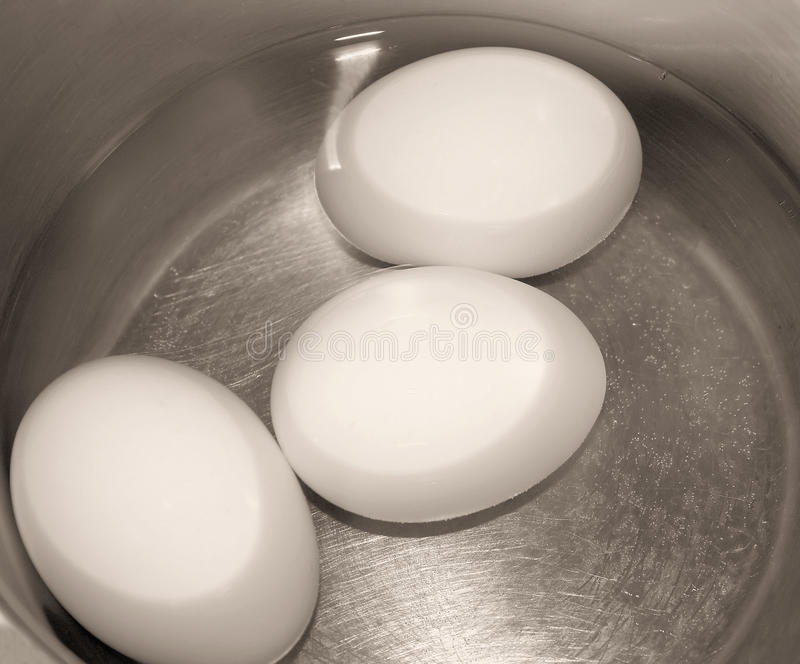 Three Eggs In Pot Of Water royalty free stock image
