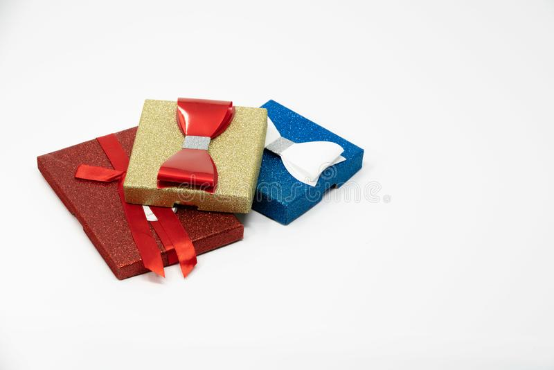 Three elegant colorful present boxes with bow ties stock photography