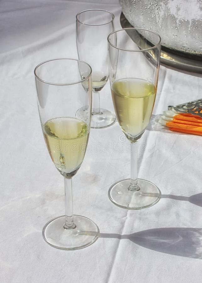 Three elegant glasses of champaigne royalty free stock photos