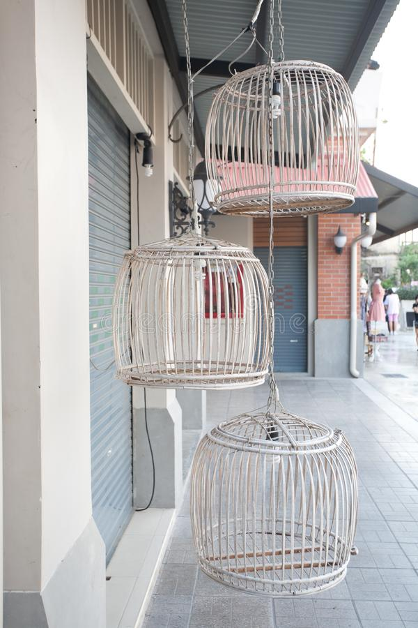Three empty birdcages Old and beautiful stock photography