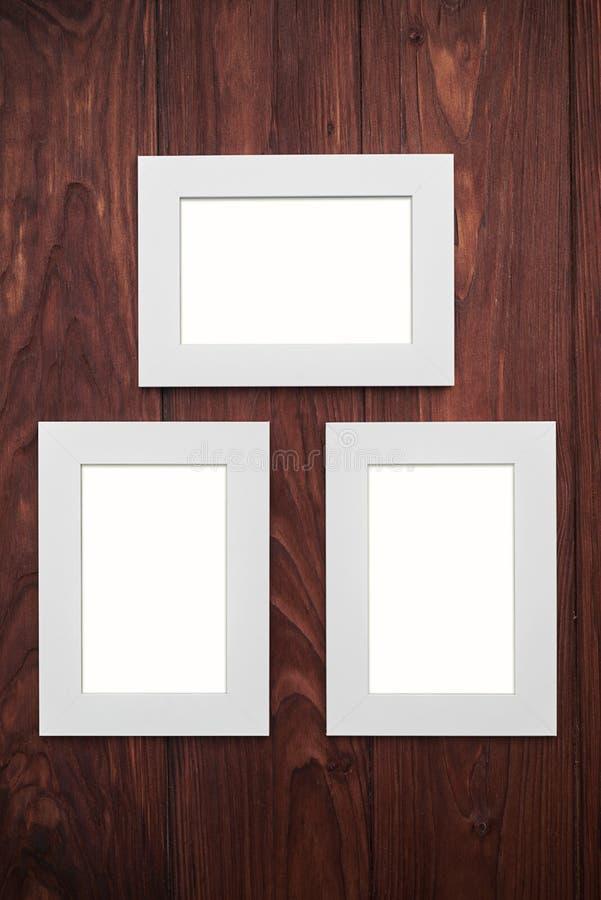 Download Three Empty Frames On Brown Wooden Desk Stock Illustration - Illustration: 70384702