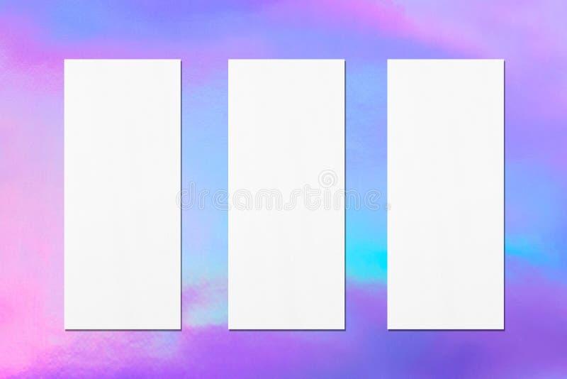 Three empty price-list or menu mockups on holographic background. Three empty price-list or menu mockups with soft shadows on holographic background. Flat lay stock image