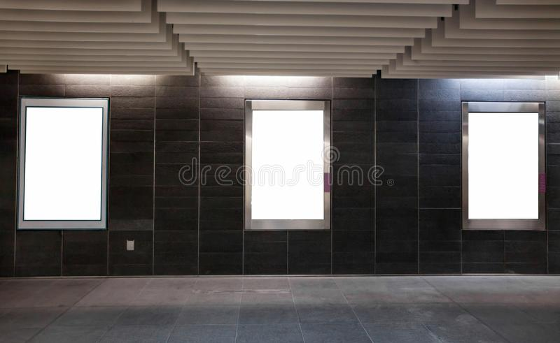Three empty white blank banners billboards in the wall royalty free stock photo