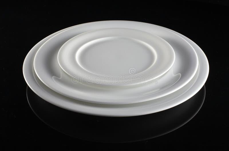 Three Empty white plates stock image