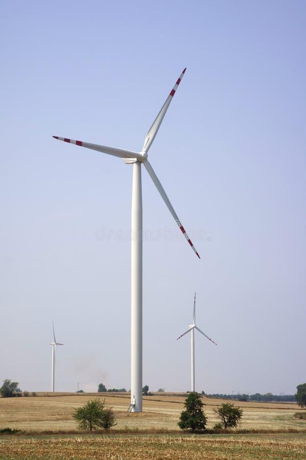 Three energy wind turbines stock photography