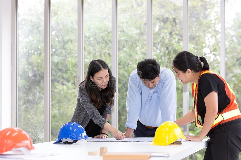 Three engineers working meeting room at the office. Group worker royalty free stock image