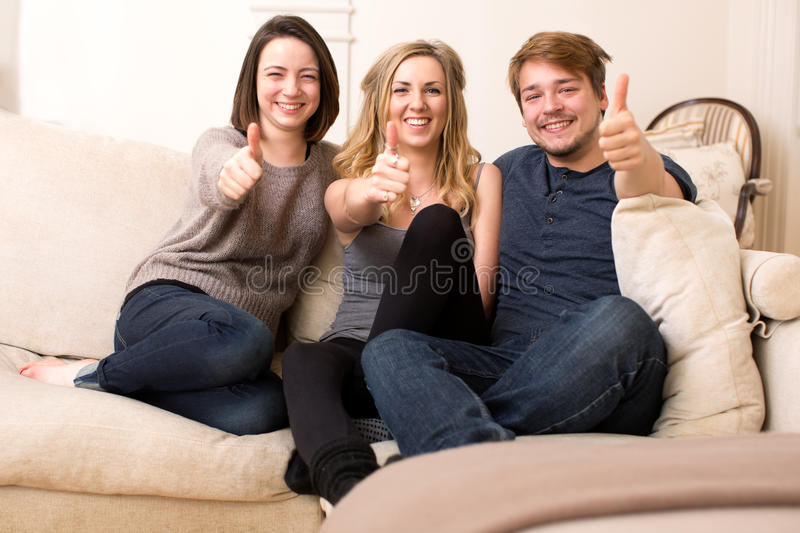 Download Three Enthusiastic Teenagers Giving A Thumbs Up Stock Photo - Image of three, together: 37265388