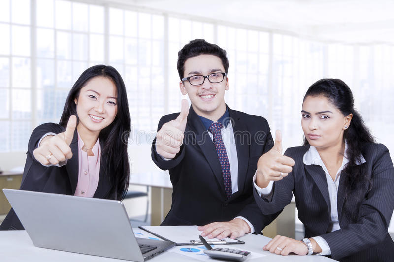 Three entrepreneur smiling in the office stock images
