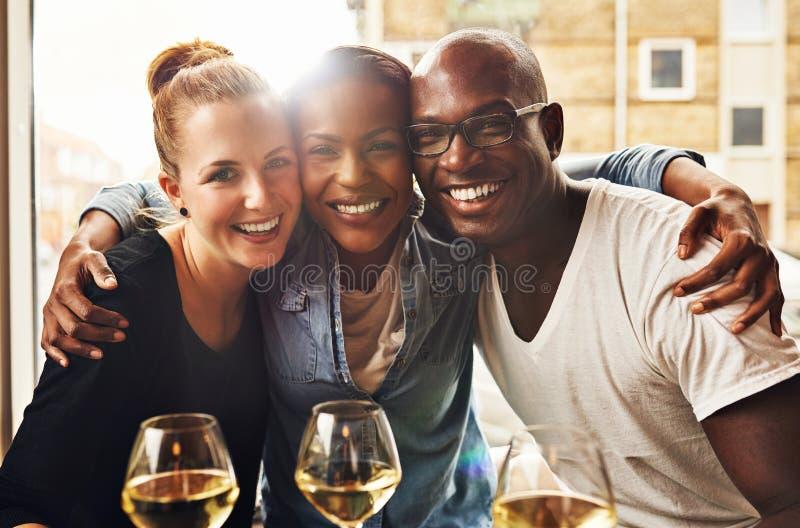 Three ethnic best friends stock photo