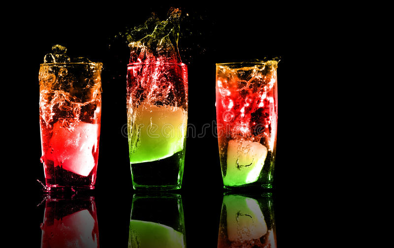 Three exotic tropical cocktails on a black backgro