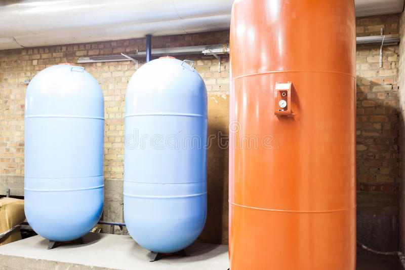 Three expansion boilers. In the basement there are three major expansion boilers stock photography