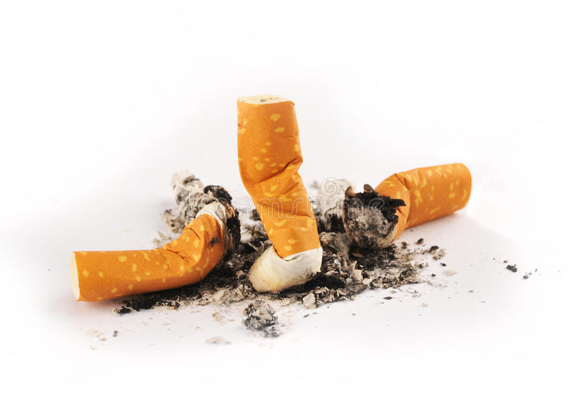 Three Extinguished Cigarettes with Ashes royalty free stock photography