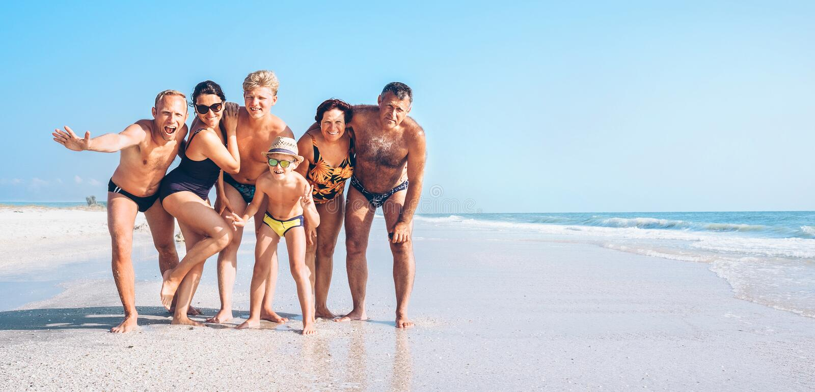 Three family generations on the one long shoot posing for group royalty free stock photography