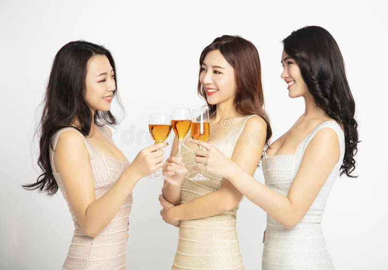 female Friends Make Toast and Celebrate At Party royalty free stock photo