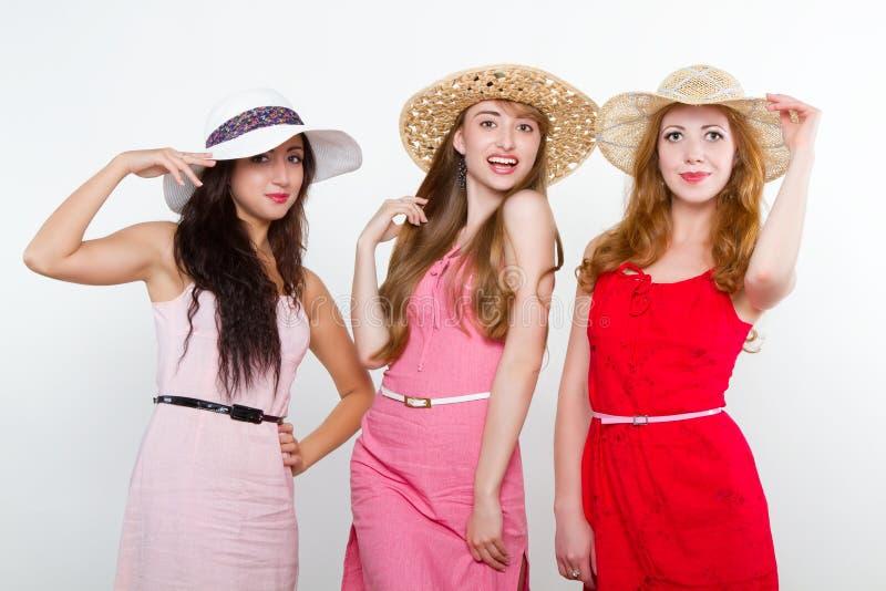 Three female friends on white background