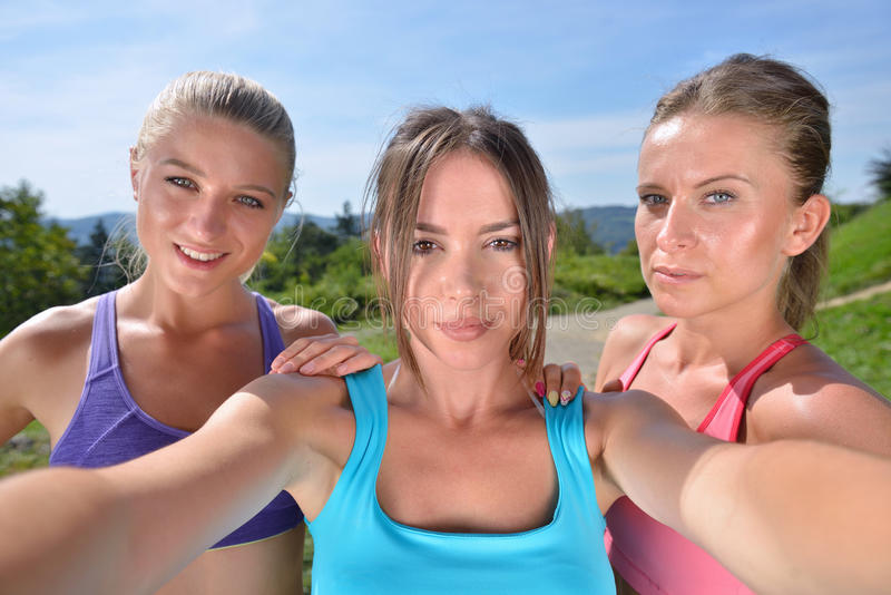Three female runners make a selfie after their first workout.  stock photo