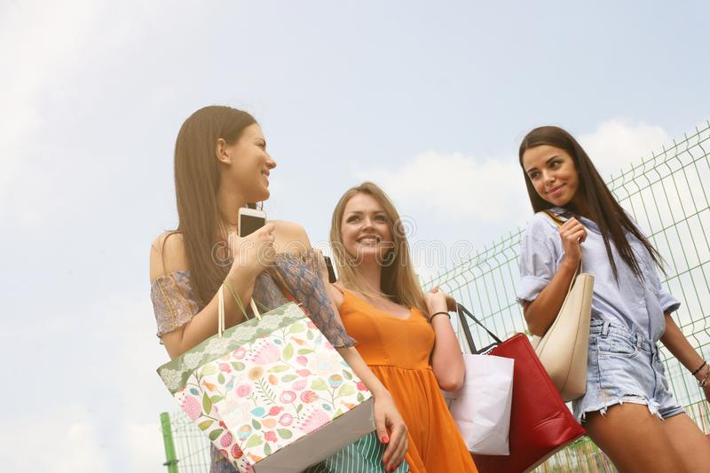 Female young friends doing shopping in the city. royalty free stock images