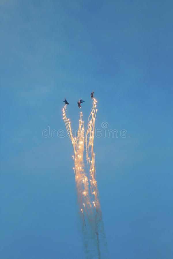 Three fighter jets in the sky stock images