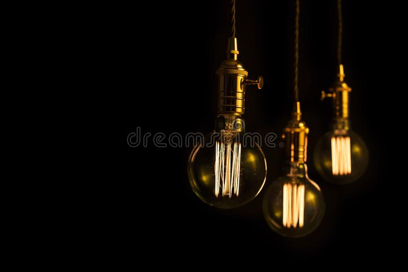 Three filament lightbulbs with copy space. Three incandescent filament lightbulbs with copy space royalty free stock images