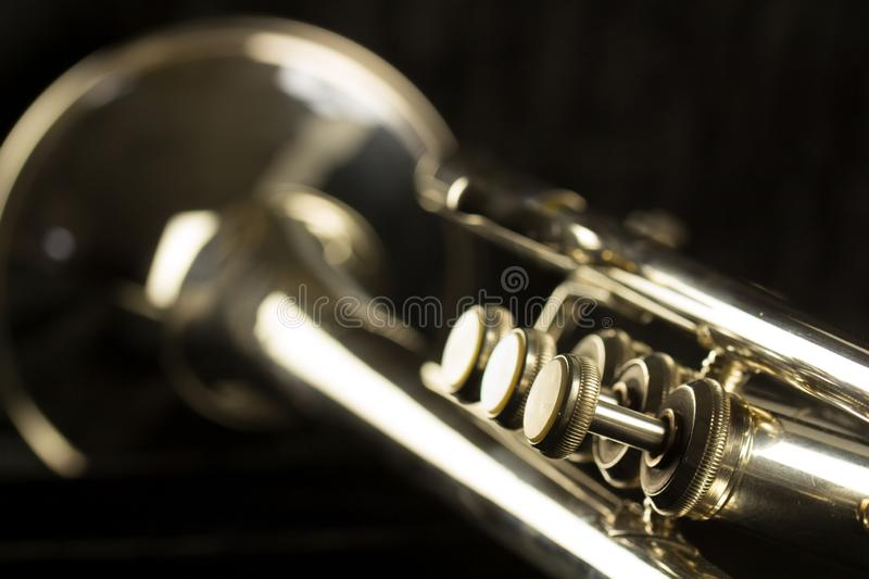 Three finger buttons close up of trumpet with bell and tuning slide royalty free stock photos
