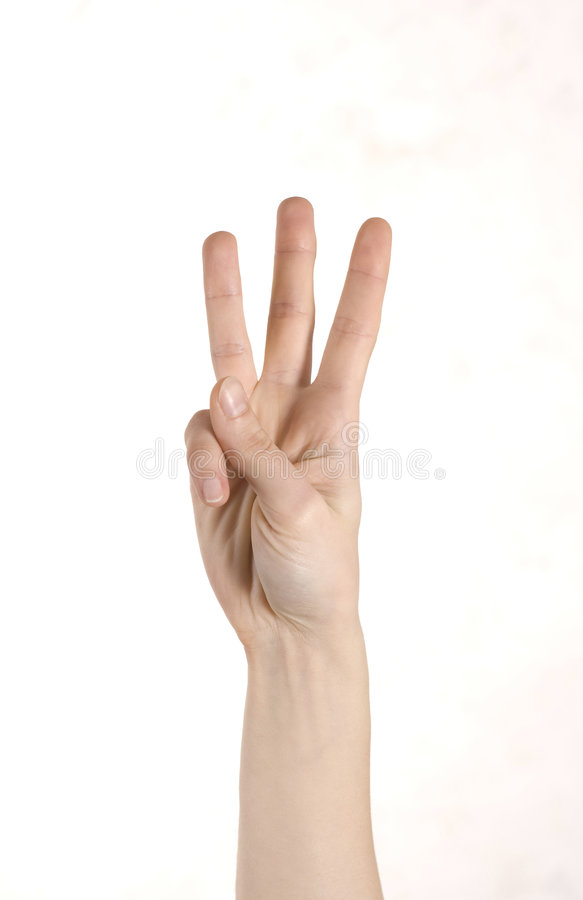 Three fingers. Woman's hand with three fingers up stock photos