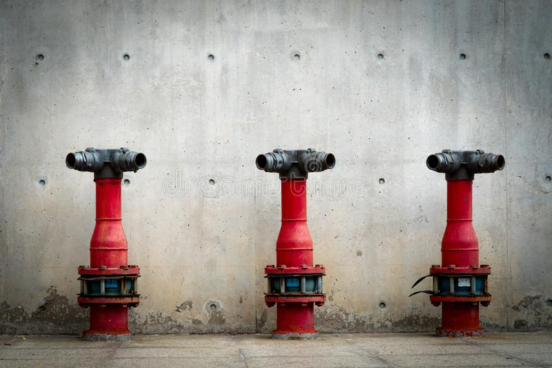 Three fire safety pump on cement floor of concrete building. Deluge system of firefighting system. Plumbing fire protection. Red fire pump in front of concrete royalty free stock images