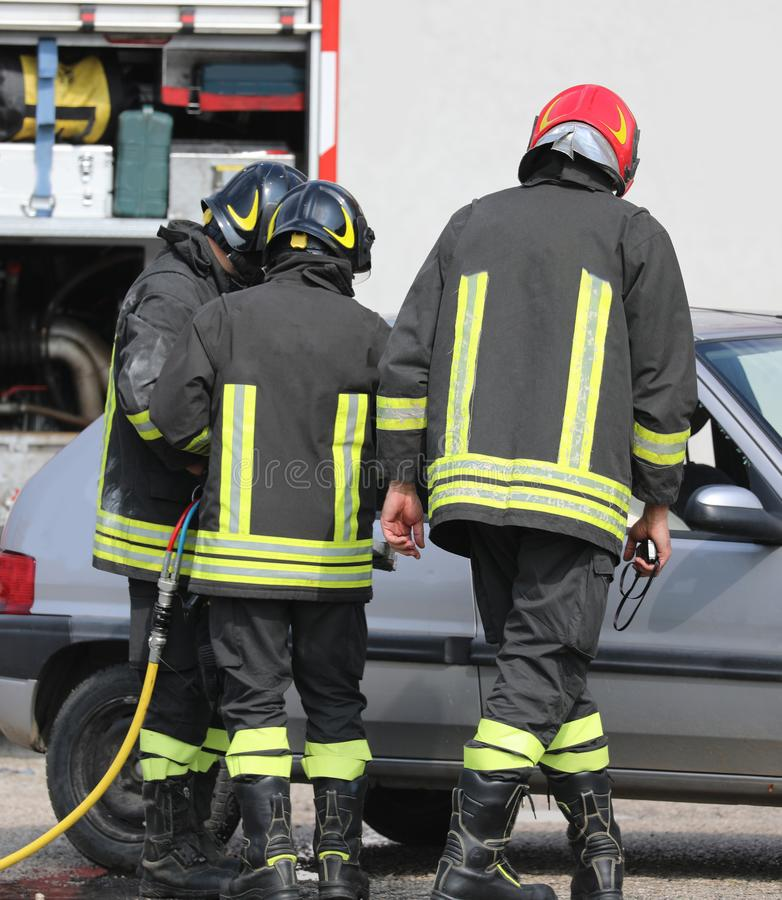 Three firefighter after the road traffic accident stock photo