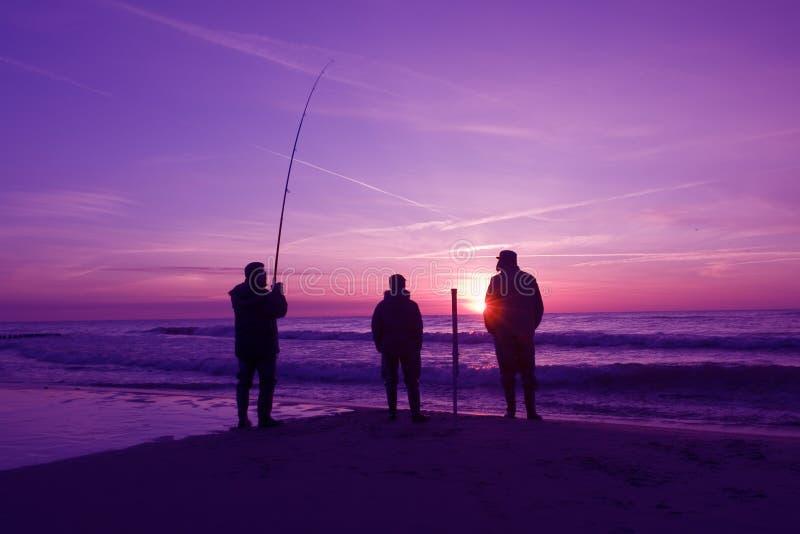 Three fishermen stock images