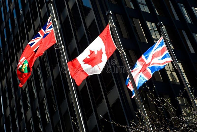 Three flags: Ontarian, Canadian, British royalty free stock photos