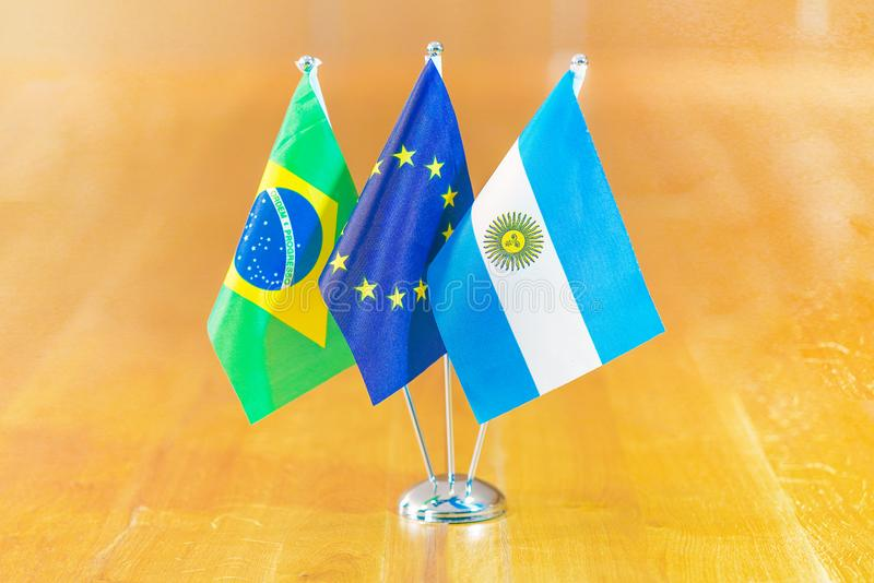 Flags of European Union, Argentina and Brazil. Three flags on the table. Flags of Brazil, European Union and Argentina. Flags of Brazil, European Union and royalty free stock photos