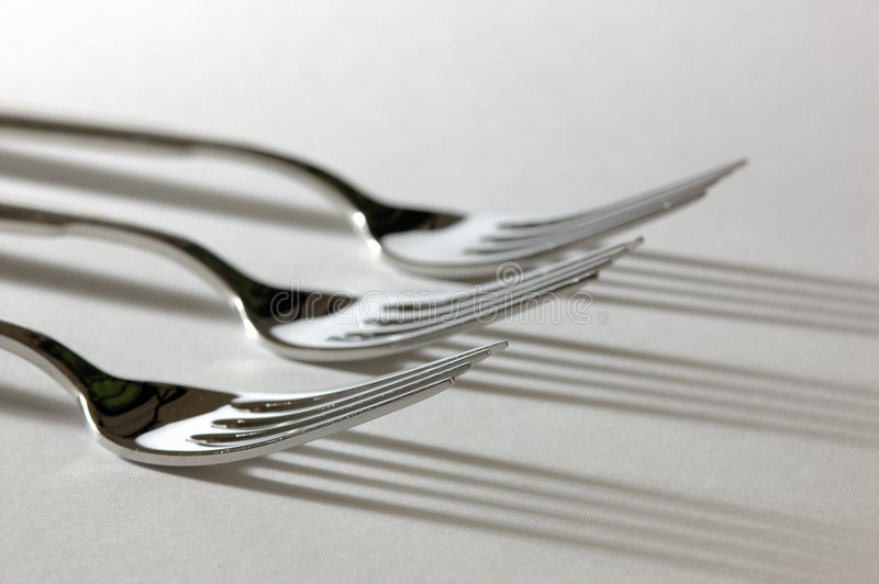 Three forks. Just three forks with nice shadows royalty free stock image