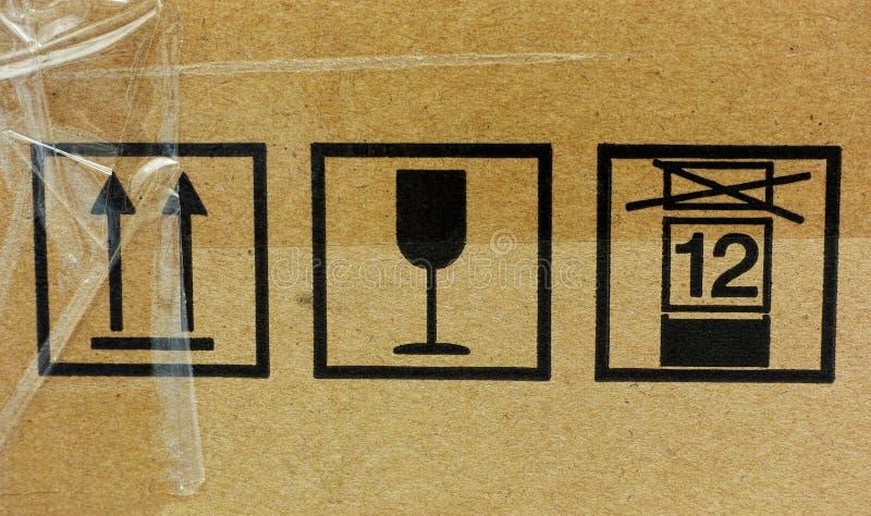 Three fragile symbol on cardboard royalty free stock photo