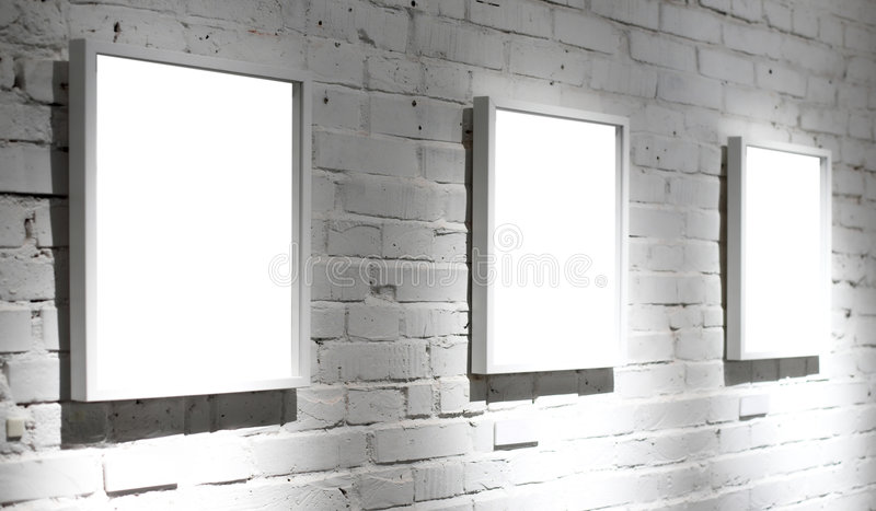 Three frames on white wall royalty free stock images