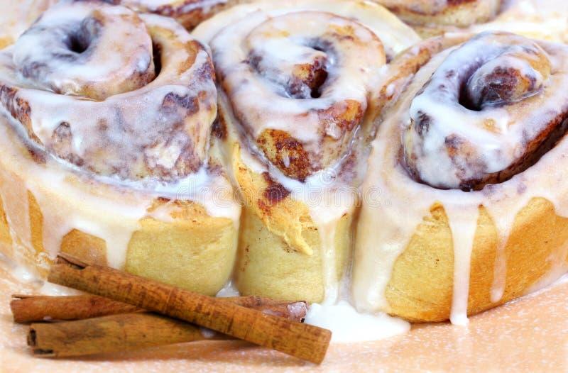 Three Fresh Baked Cinnamon Buns stock images