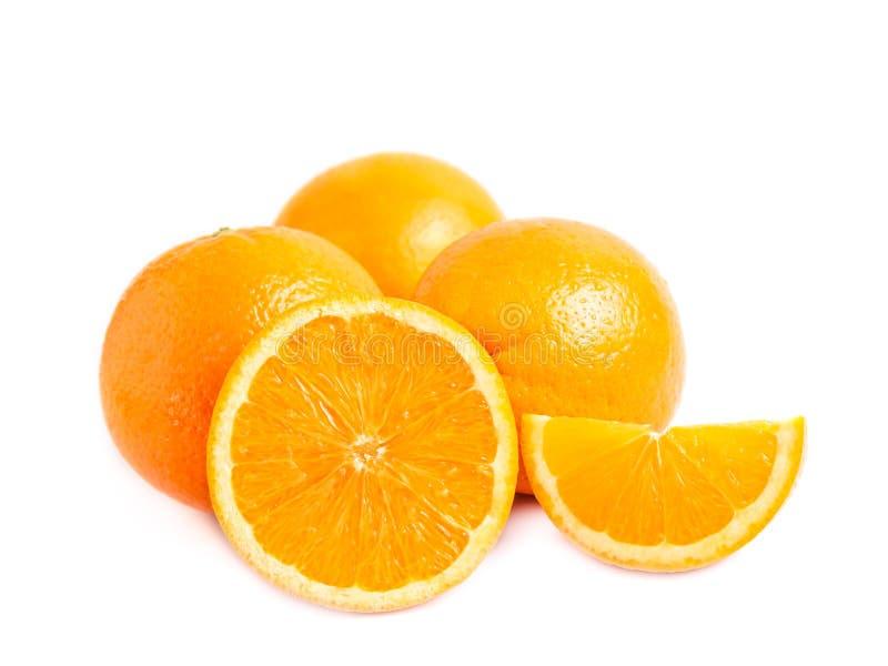 Three fresh juicy oranges one half and a lobule slice of orange isolated on white background. stock images