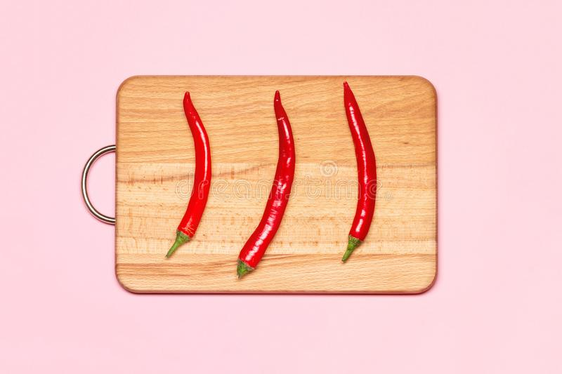 Three Fresh Red Chilli Peppers royalty free stock image