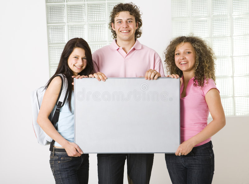 Download Three Friends With Blank Table Stock Image - Image: 5408223