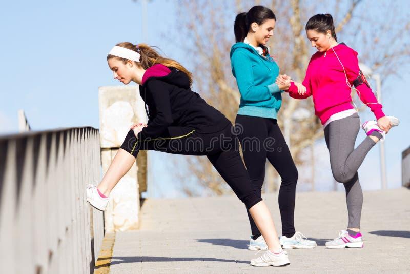 Three friends doing push-ups royalty free stock photography