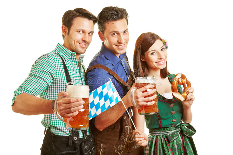 Three friends drinking beer at stock photo